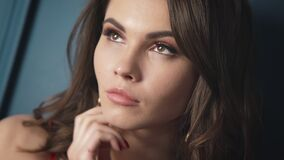 Closeup portrait woman brunette hair style fashion model sexy looking passion lips bright makeup cosmetic beauty product lyric rom