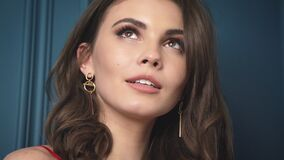 Closeup portrait woman brunette hair style fashion model sexy looking smile lips bright makeup cosmetic beauty product lyric roman