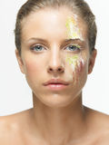 Closeup portrait woman colorful powders on face Stock Photo