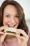 Closeup portrait of a woman eating sandwich Stock Photography