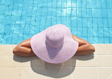 Closeup portrait of woman enjoying swimming pool Stock Photos
