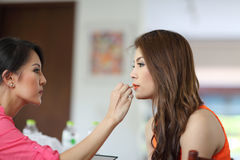 Closeup portrait of a woman having applied makeup by makeup arti Royalty Free Stock Photo