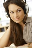 Closeup portrait of woman with headphones royalty free stock image