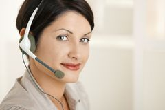 Closeup portrait of woman with headset Stock Photography