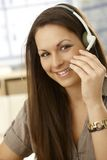 Closeup portrait of woman with headset Stock Image