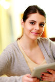 Closeup portrait of a woman holding tablet computer Stock Photo