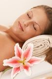 Closeup portrait of woman lying on massage bed Royalty Free Stock Image