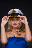 Closeup portrait of woman in sailor cap Royalty Free Stock Photos