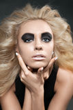 Closeup portrait of a woman with smoky eye makeup Royalty Free Stock Photo