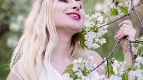 Closeup portrait of a woman in spring. stock footage