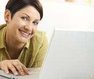 Closeup portrait of woman using laptop Royalty Free Stock Photography