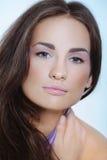Closeup portrait of woman in violet color dress Stock Photos