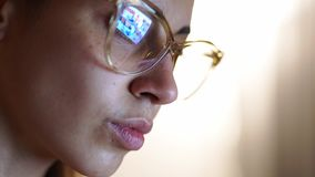 Closeup portrait of woman working at home and using computer touchscreen, looking at monitor