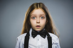 Closeup Portrait of wondering girl going surprise on gray background Stock Photography