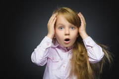 Closeup Portrait of wondering girl going surprise on gray background Royalty Free Stock Photography