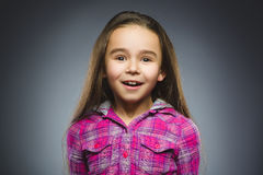 Closeup Portrait of wondering girl going surprise on gray background royalty free stock photo