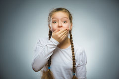 Closeup Portrait of wondering girl going surprise on gray background royalty free stock image