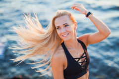 Closeup portrait of young active woman smiling on beach Royalty Free Stock Images
