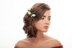 Closeup portrait of young adorable brunette woman with flower headpiece and cute makeup posing on white studio background Royalty Free Stock Photos