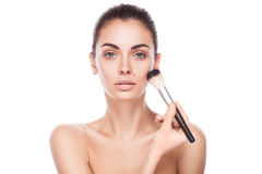 Closeup portrait of young adult woman with brush for makeup Royalty Free Stock Photo