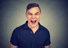 Portrait of young angry man screaming royalty free stock photography