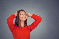 Angry woman covering ears looking up stop loud noise. Closeup portrait young angry unhappy stressed woman covering her ears looking up stop making loud noise it` stock photos