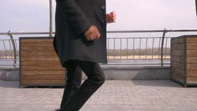 Closeup portrait of young attractive african american businessman walking and dancing smiling happily on the street in. The urban city stock footage