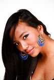 Closeup portrait of a young beautiful asian model. With makeup and jewelry stock photography