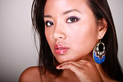 Closeup portrait of a young beautiful asian model. With makeup and jewelry royalty free stock images