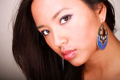 Closeup portrait of a young beautiful asian model. With makeup and jewelry royalty free stock photography