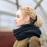 Closeup portrait of young beautiful blonde woman with a dreadlocks bun hairstyle Stock Image