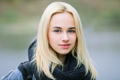 Closeup portrait of a young beautiful blonde woman outdoors Stock Photography