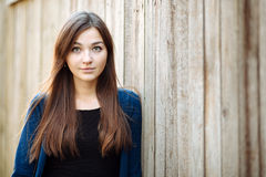 Closeup portrait of a young beautiful brunette woman outdoor Royalty Free Stock Photo