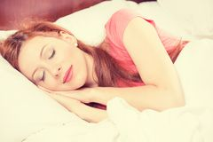 Closeup portrait young beautiful girl sleeping in the bedroom Royalty Free Stock Photos