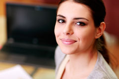 Closeup portrait of a young beautiful smiling woman Stock Photo