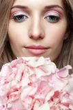 Closeup portrait of young beauty female face with blond hair and Stock Photo