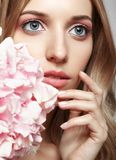 Closeup portrait of young beauty female face with blond hair and Royalty Free Stock Image