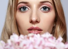 Closeup portrait of young beauty female face with blond hair and Royalty Free Stock Images