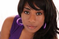 Closeup portrait of young black woman purple Stock Photo