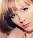 Closeup portrait of young blond beautiful girl Royalty Free Stock Images