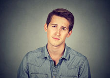 Closeup portrait of young bored man Stock Photography
