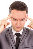 Closeup portrait of  a young business man with headache rubbing Royalty Free Stock Images