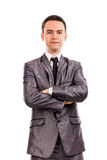 Closeup portrait of a young businessman with arms folded Royalty Free Stock Images