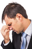 Closeup portrait of young businessman with strong headache Stock Photo