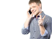 Closeup portrait of young businessman using mobile phone. Smiling Royalty Free Stock Image