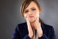 Closeup portrait of a young businesswoman having toothache Royalty Free Stock Image