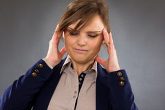 Closeup portrait of a young businesswoman with headache Royalty Free Stock Photo