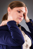 Closeup portrait of a young businesswoman suffering from neck pa Royalty Free Stock Image