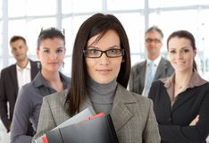 Closeup portrait of young businesswoman and team Royalty Free Stock Images
