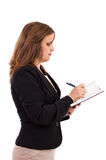 Closeup portrait of a young businesswoman writing in her noteboo Royalty Free Stock Photos
